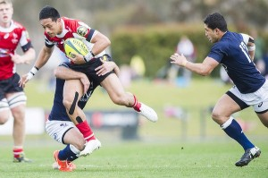 Christian Lealiifano getting brought down against Qld Country. Photo by Jay Cronan