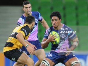 Lopeti Timani of the Rising runs the ball against Perth Spirit. Photo by Scott Barbour