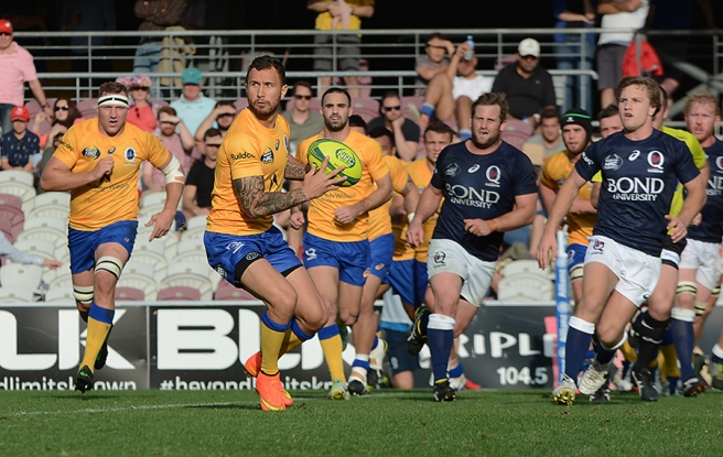 Quade Cooper, ball in hand during the NRC's Queensland derby.  Sourced from:  www.greenandgoldrugby.com