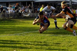 Brad Kapa scoring the final try for the Rams in their 32-31 point loss to the Eagles. (JB Photography)