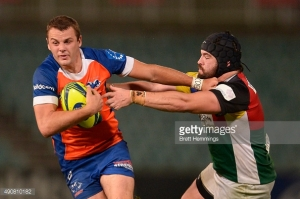 Paul Asquith running the ball for the home side against the Rays. Photo sourced from GettyImages